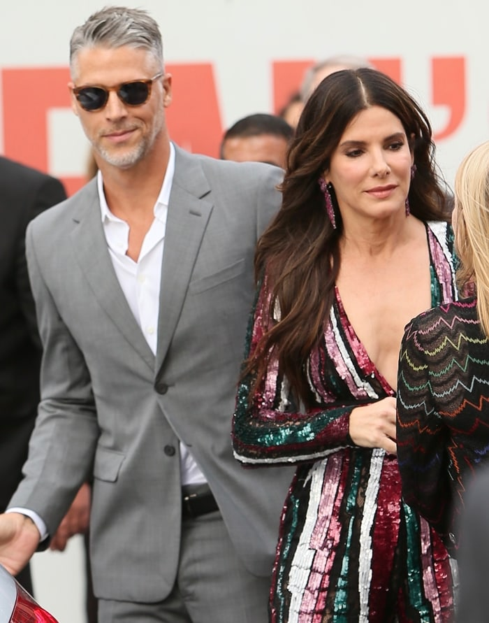 Sandra Bullock met her boyfriend Bryan Randall when she hired him to snap pics at her son Louis' birthday party