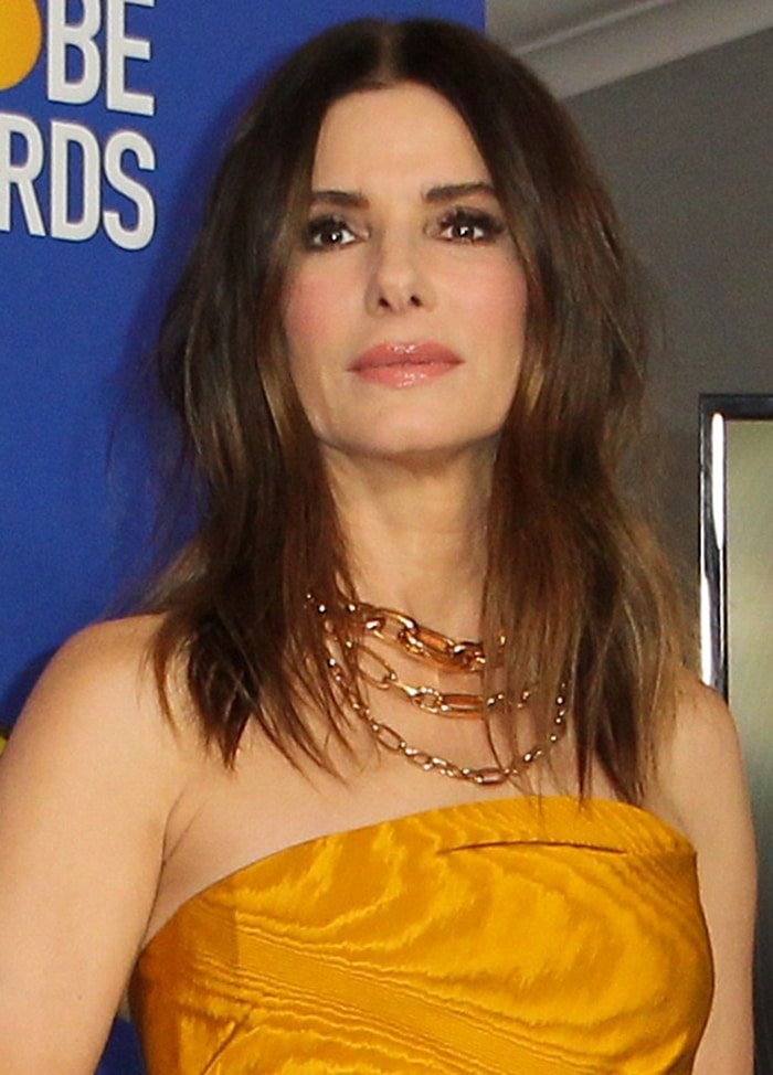Sandra Bullock accentuated her eyes with mascara and wore her hair in tousled loose waves