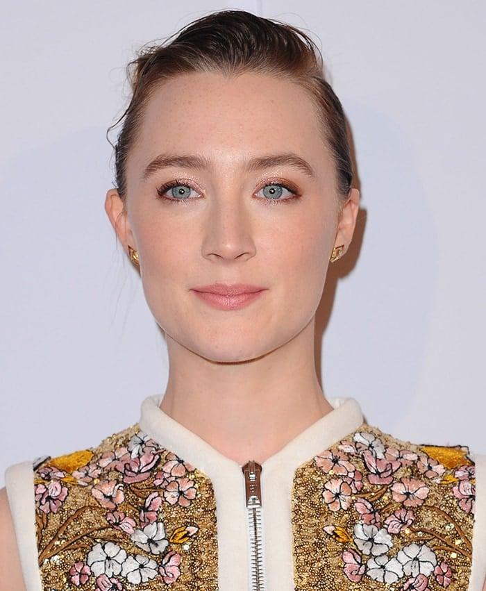 Saoirse Ronan wears a chic bun with soft pink makeup