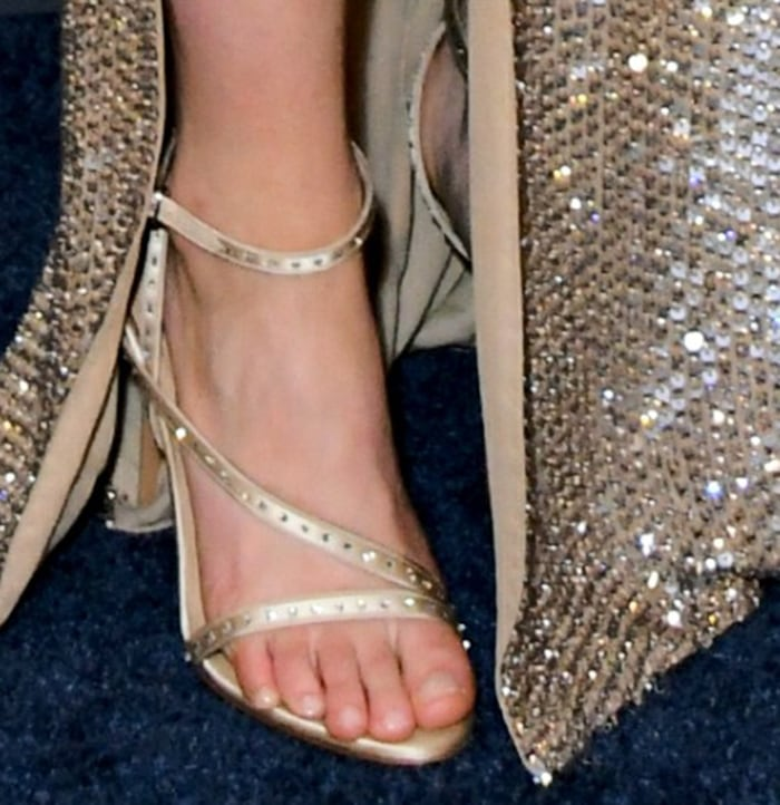 Saoirse Ronan shows off her feet in gold strappy sandals