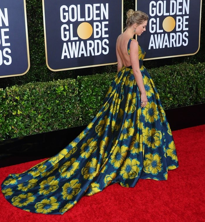 Taylor Swift's high heels could not be seen due to the length of her Etro navy silk jacquard floral print ball gown