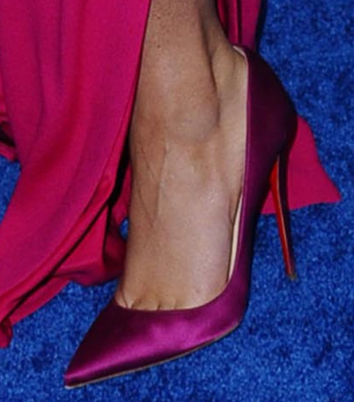Zendaya complements her pink outfit with magenta Christian Louboutin pumps