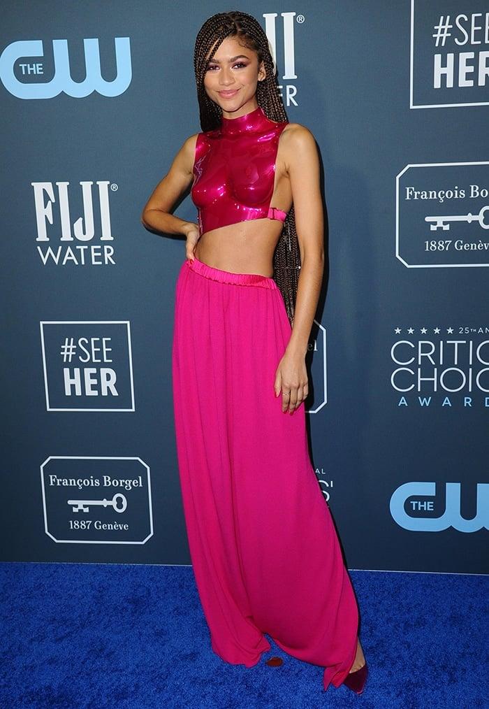 Zendaya wears a hot pink breastplate at the 25th Annual Critics Choice Awards held at Santa Monica's Barkar Hangar on January 12, 2020