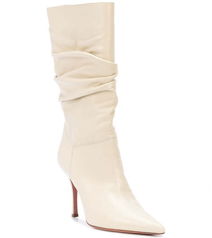 Light cream leather Ida slouchy boots from Amina Muaddi featuring a pointed toe, gathering details, a slip-on style, a mid-calf length and a high stiletto heel
