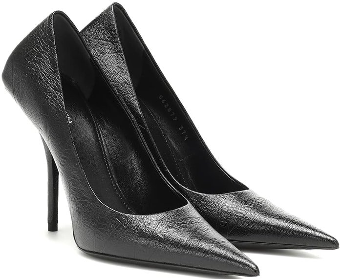 Balenciaga's take on wear-anywhere black stiletto pumps come sharply angled – with exaggerated, reinforced flat heel counters, and precisely pointed toes – for a twist on a classic silhouette