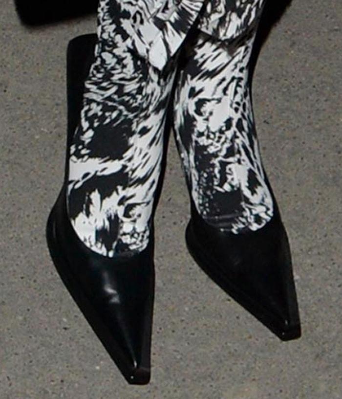 Bella Hadid teams zebra-printed leggings with Balenciaga black pumps