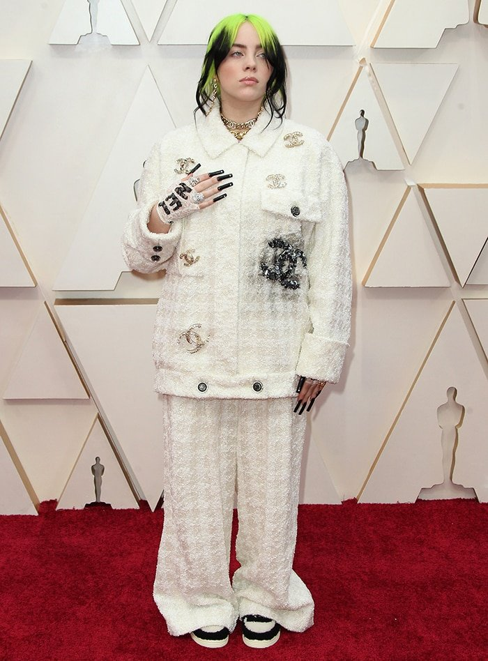 Billie Eilish sports a messy but chic updo and soft makeup-look