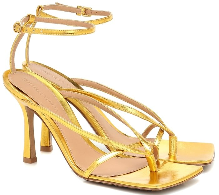 Take shimmering strides in these strappy sandals from Bottega Veneta