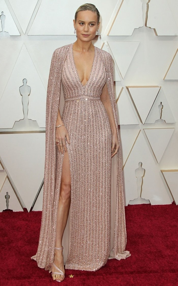 Brie Larson donned a glittering gown boasting 120,000 sequins, 110,000 glass beads, and 6,500 pink jewels