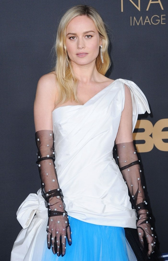Brie Larson wearing pearl-embellished gloves at the 51st NAACP Image Awards