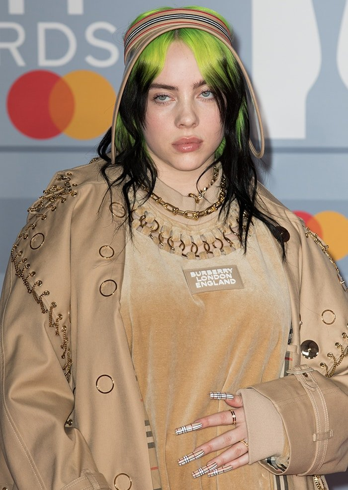 Billie Eilish completes her Burberry look with long plaid nails and sun visor