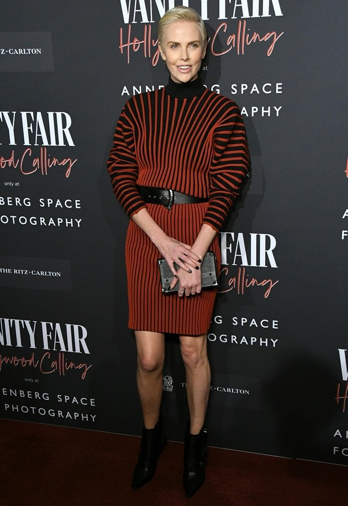 Charlize Theron wows in a red a Louis Vuitton look at the exhibit opening of Vanity Fair: Hollywood Calling – The Stars, The Parties and The Powerbrokers