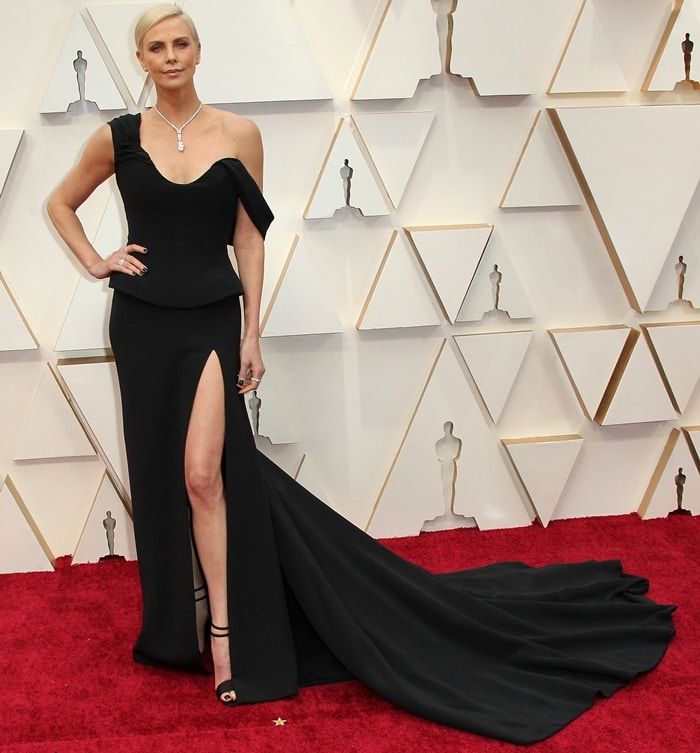 Charlize Theron wearing a black Christian Dior Haute Couture gown with Tiffany & Co jewelry