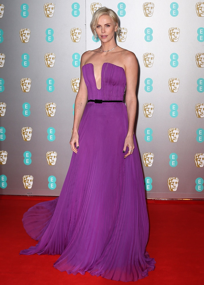 Charlize Theron brings color to the red carpet at the 73rd British Academy Film Awards at Royal Albert Hall in London on February 2, 2020