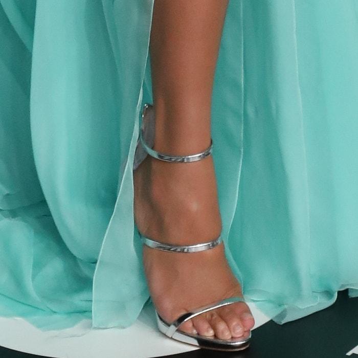 Chrissy Teigen showed off her feet in silver Giuseppe Zanotti sandals