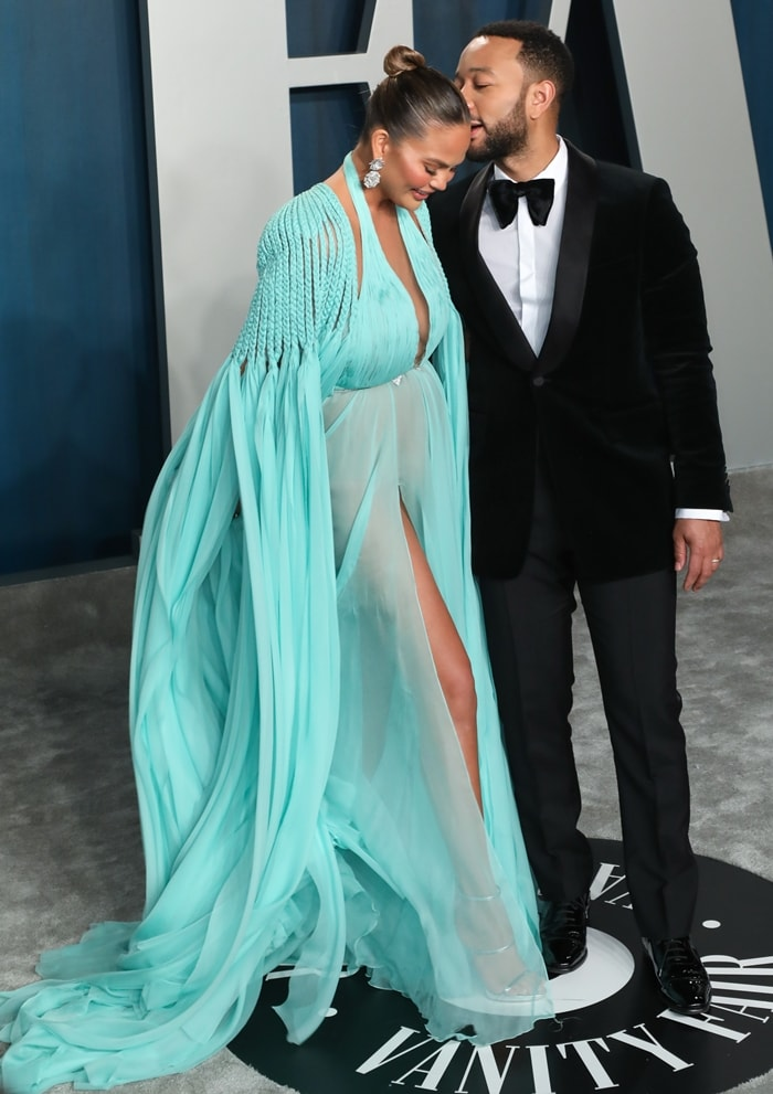 Chrissy Teigen enjoying a moment with her husband John Legend while arriving at the 2020 Vanity Fair Oscar Party