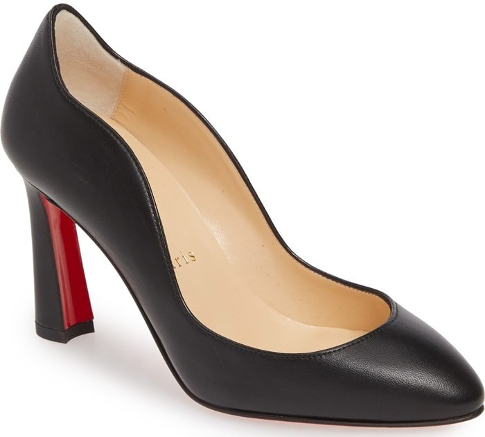 A sinuous wavy topline distinguishes an Italian-crafted pump elevated by a flared heel and finished with Christian Louboutin's iconic red sole