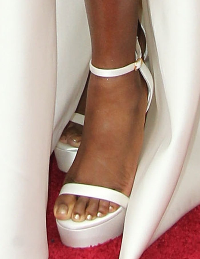 Cynthia Erivo shows off her feet in white Stuart Weitzman sandals