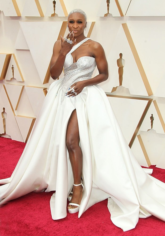 Best actress nominee Cynthia Erivo shows off her diamond Piaget rings and mismatched talon nails