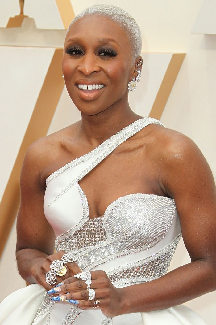 Cynthia Erivo wears her pearl blonde buzzcut with smokey eyeshadow with nude lipstick