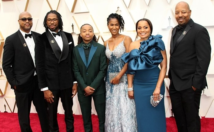 Director Matthew A. Cherry (2nd L), producer Karen Rupert Toliver (2nd R), Deandre Arnold, and family members attend the 92nd Annual Academy Awards