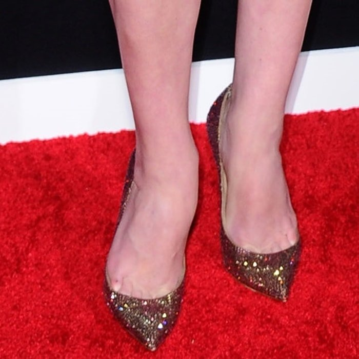 Elisabeth Moss shows off her feet in glittering Christian Louboutin pumps