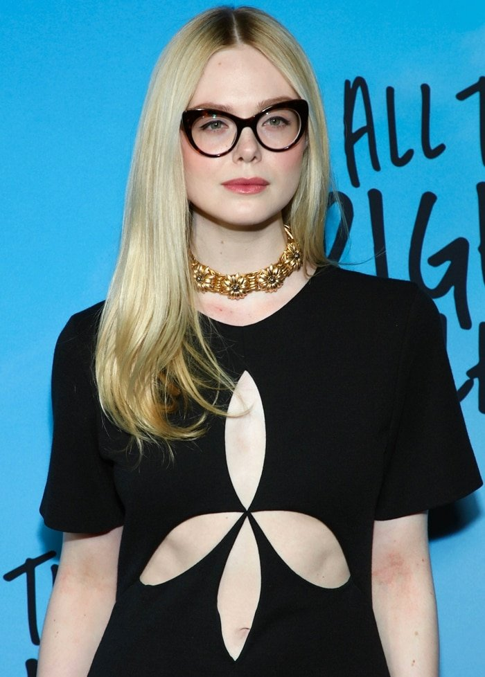 Elle Fanning's belly button and gold choker that is formed by flower details