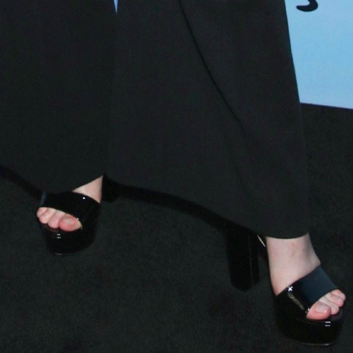 Elle Fanning shows off her feet in black platform sandals