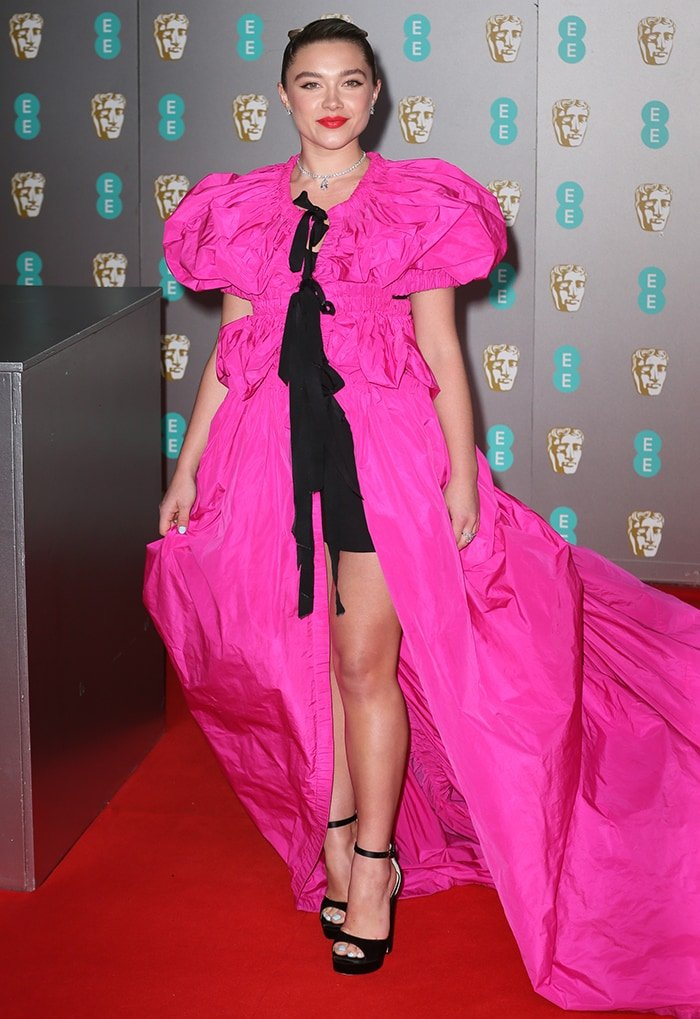Florence Pugh in hot pink Dries Van Noten cape dress at the 2020 BAFTA in London on February 2, 2020