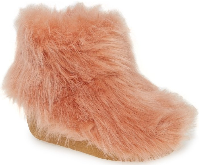 Add a fuzzy finishing touch to any cold-weather look with this faux-fur covered bootie grounded by a hidden crepe heel and textured sole for superb traction