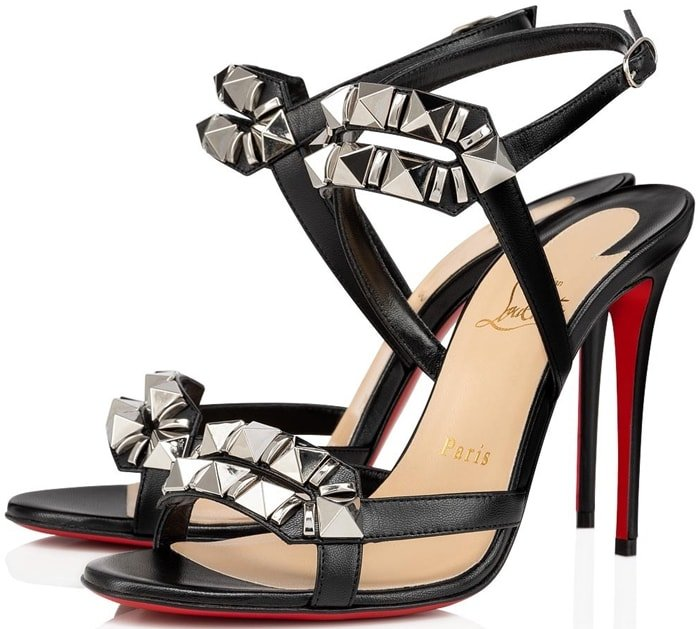 Gleaming mixed studs punctuate the straps of an Italian-crafted black leather sandal finished with a willowy stiletto heel and that iconic red sole