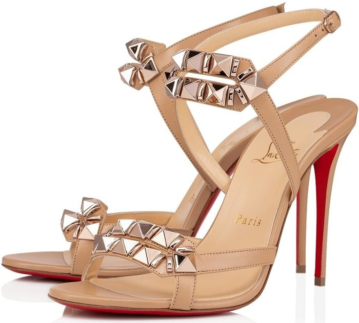 Christian Louboutin's 'Galerietta' sandals are hand-embellished with pyramid studs that glisten gorgeously against the beige leather straps
