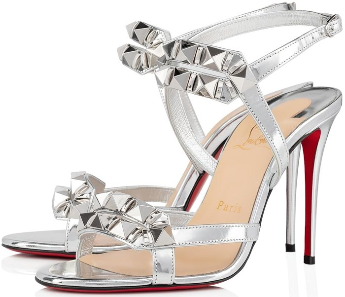 Delicate futuristic silver Specchio straps are adorned with pyramidal spikes, emphasising the toe cleavage for edgy, contemporary evening wear