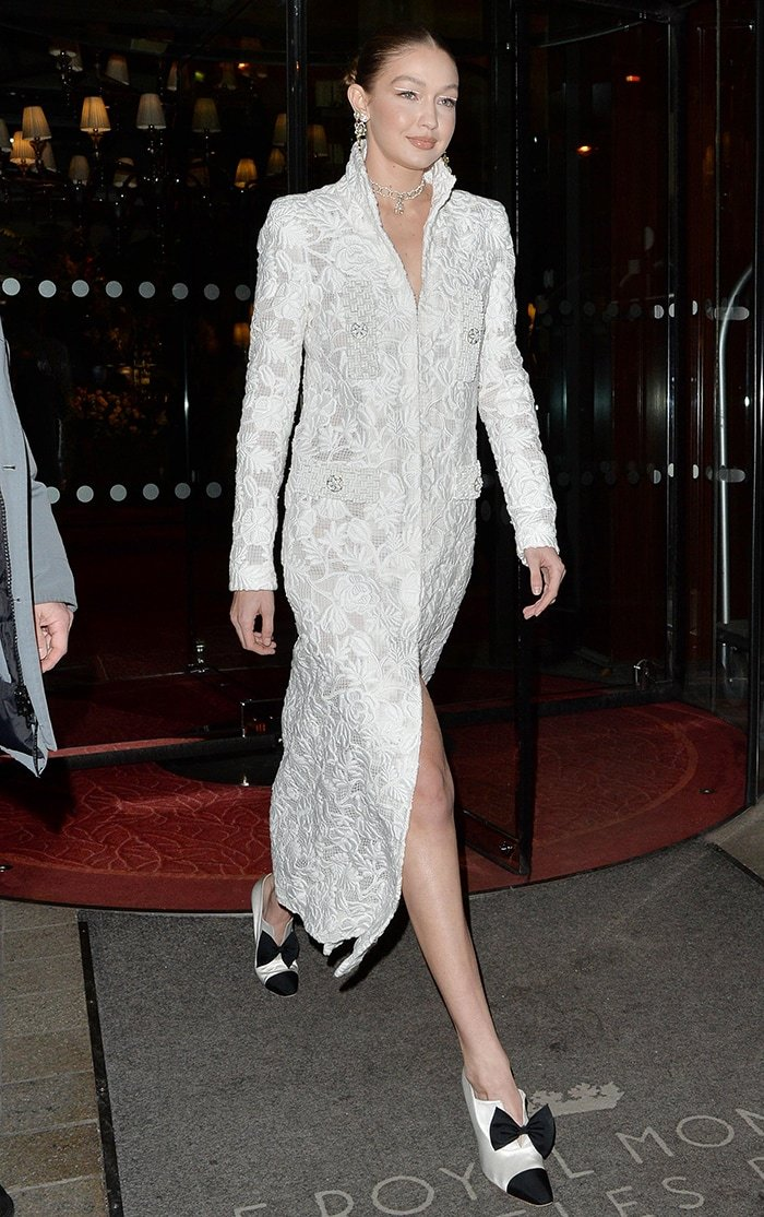Gigi Hadid in white Chanel dress at Harper's Bazaar Exhibition in Paris on February 26, 2020