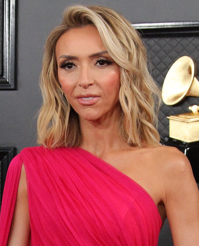 Giuliana Rancic wears shimmery pink eyeshadow and lipstick to match her dress