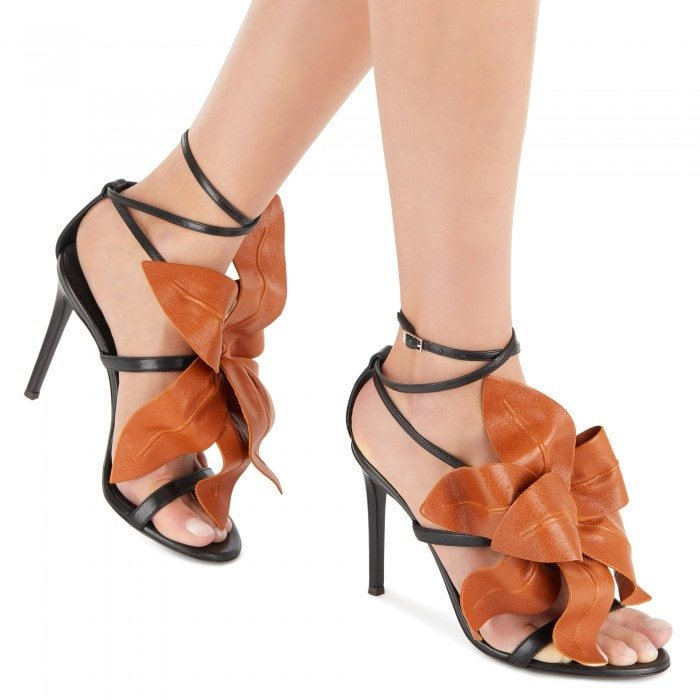 These high-heel, black leather sandals with ankle strap are embellished by the handmade, adjustable, caramel Flower accessory