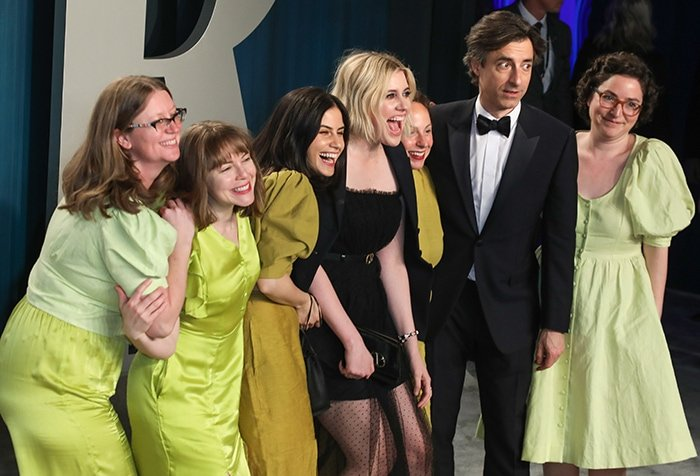 Greta Gerwig with her partner Noah Baumbach and her friends dressed in coordinating green outfit at the Vanity Fair Oscar Party