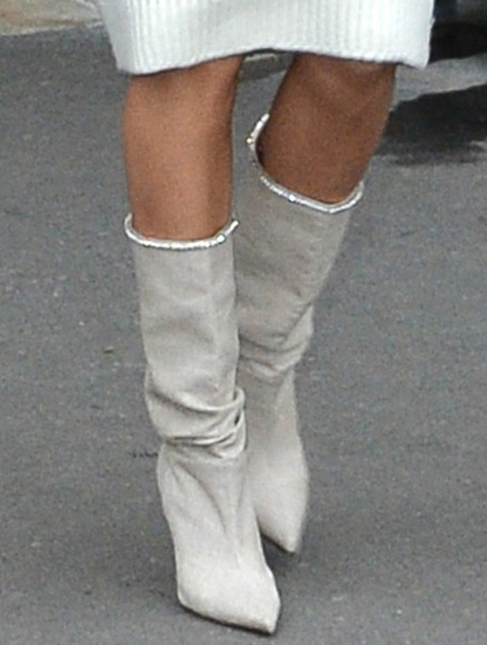 Hailey Bieber pairs her cream look with Amina Muaddi slouch boots