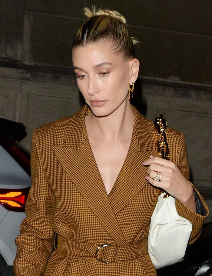 Hailey Bieber looks beautiful with neutral makeup and neat bun