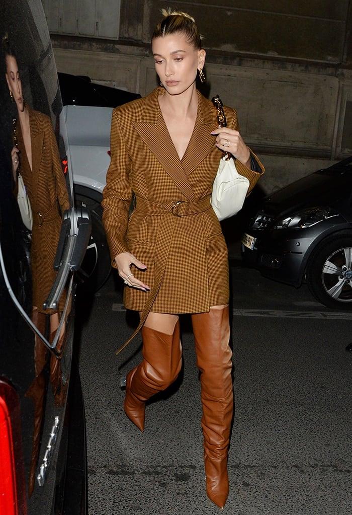 Hailey Bieber wears a chestnut-colored Mulberry blazer as a dress