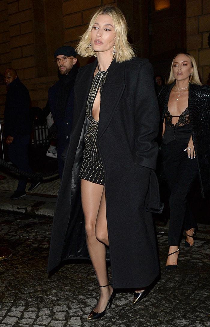 Hailey Bieber flaunts her legs in a Saint Laurent mini dress