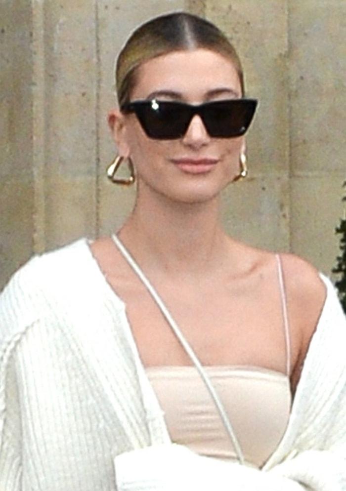 Hailey Bieber accessorizes with Bottega Veneta twisted triangle earrings