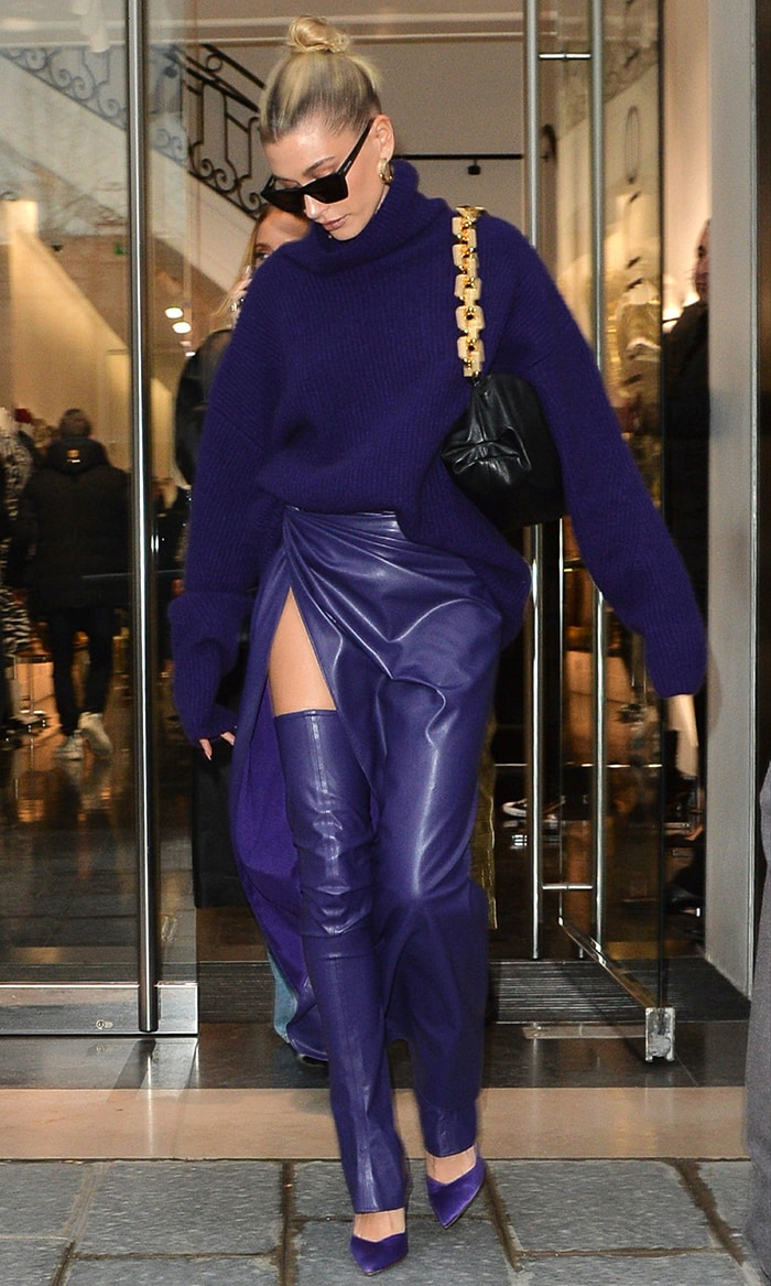 Hailey Bieber trades her green suit for a purple knit and leather outfit