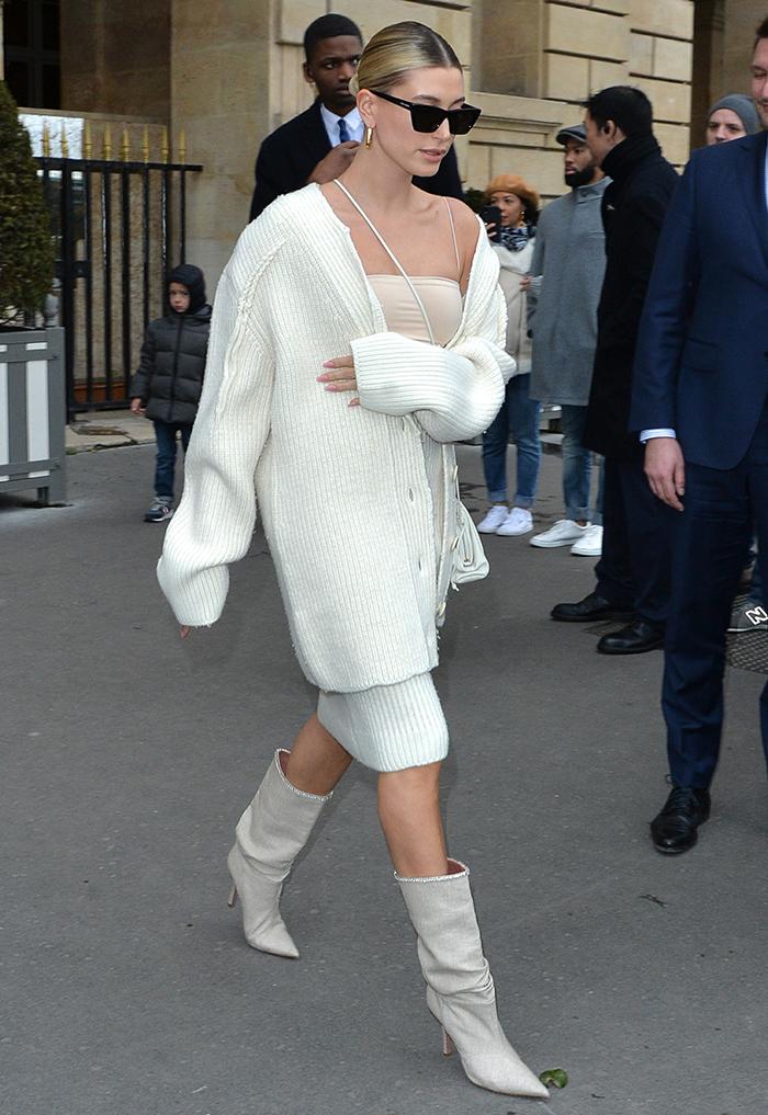 Hailey Bieber struts her stuff in Bottega Veneta skirt and cardigan with Meshki crop top