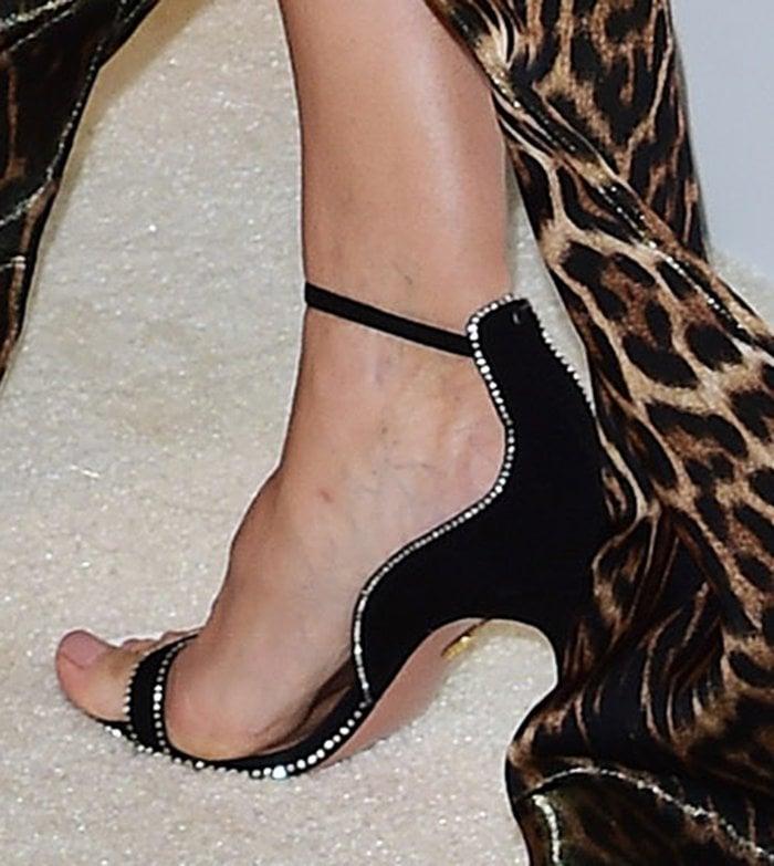 Heidi Klum adds a hint of sparkle to her wild look with Aquazzura heels