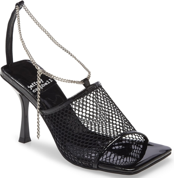 Extreme angles add to the avant-garde attitude of this mesh-strap sandal secured by a shining chain strap
