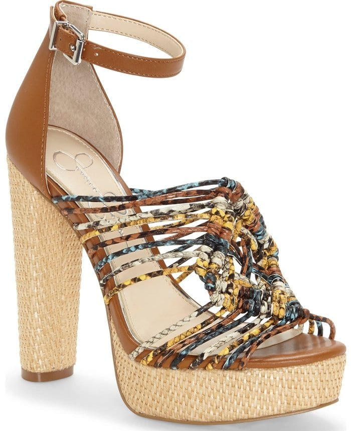 A diamond-shaped cluster of knotted cords brings Southwestern flair to an ankle-strap sandal with a towering, basket-wrapped heel and platform