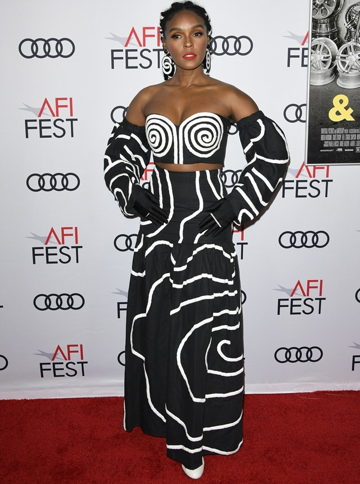 Janelle Monáe rocks a Mara Hoffman look with Dena Kemp and Hirotaka jewelry at the 2019 AFI Fest