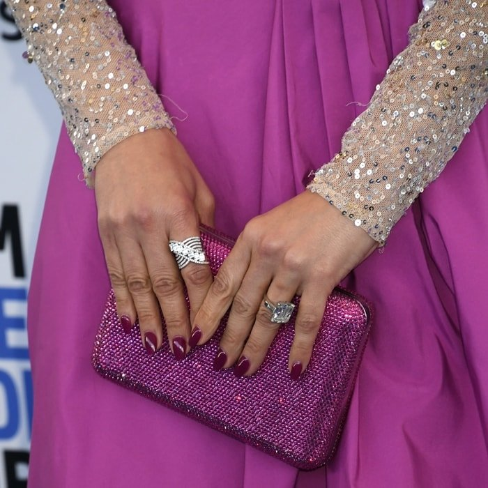 Jennifer Lopez toting an ultra-glam hinged Judith Leiber clutch encrusted with crystals