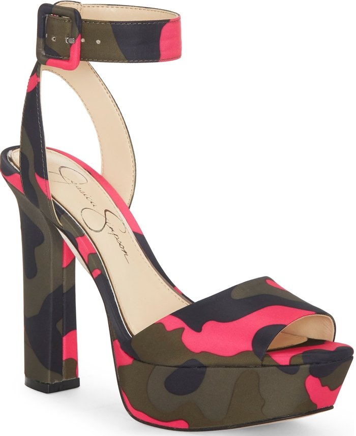 A floating ankle strap with a covered-buckle closure tops a statuesque Maicie sandal from Jessica Simpson lifted by a thick platform